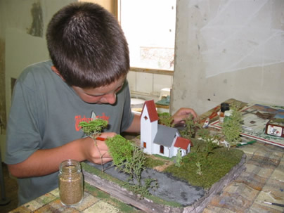 F-Hallier-A child finishing a scale model during an initiation week
